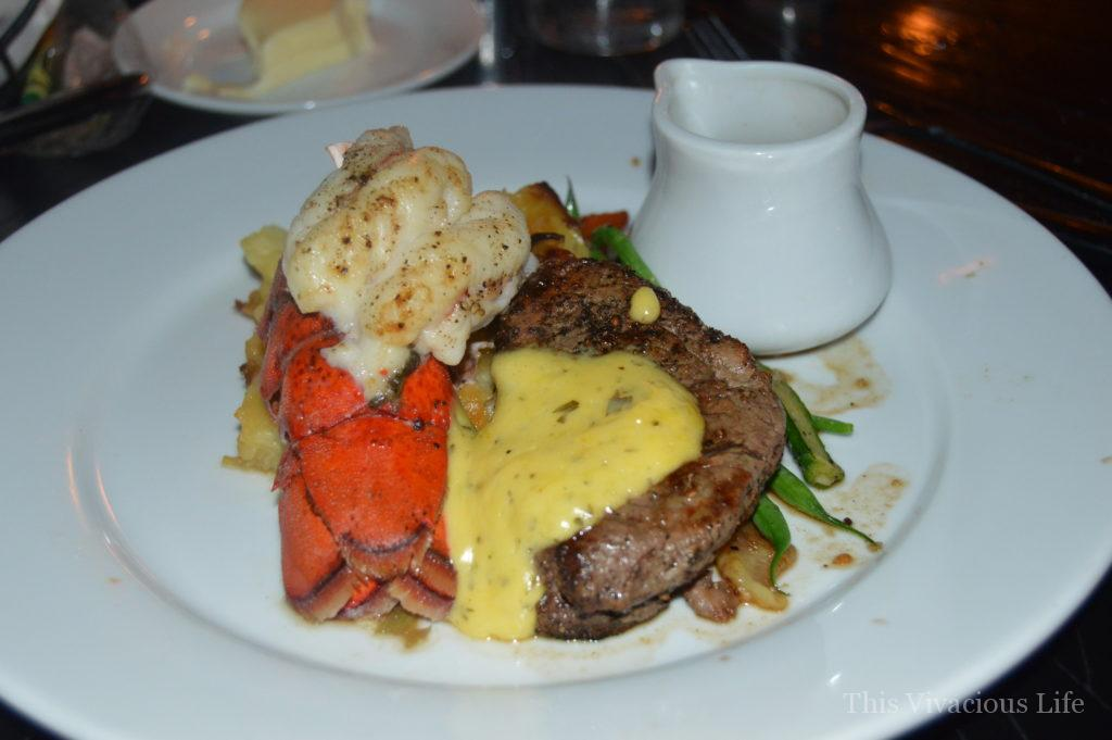Lobster and steak on a white plate