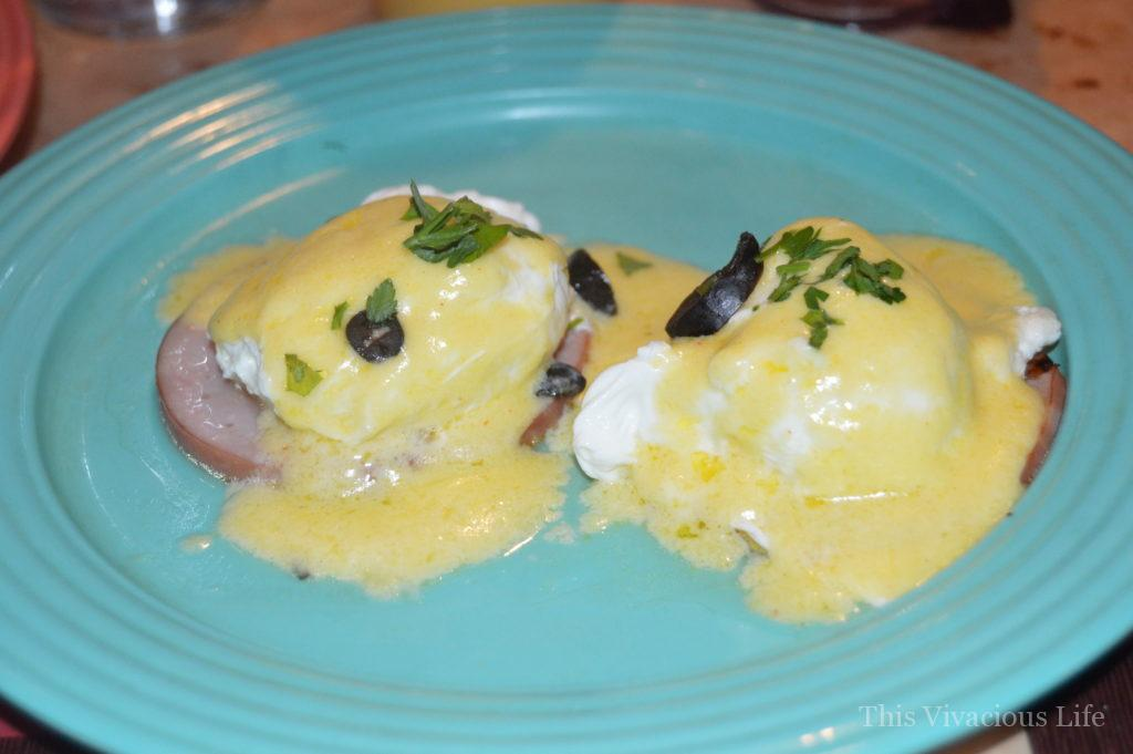 Gluten-free eggs Benedict on a blue plate