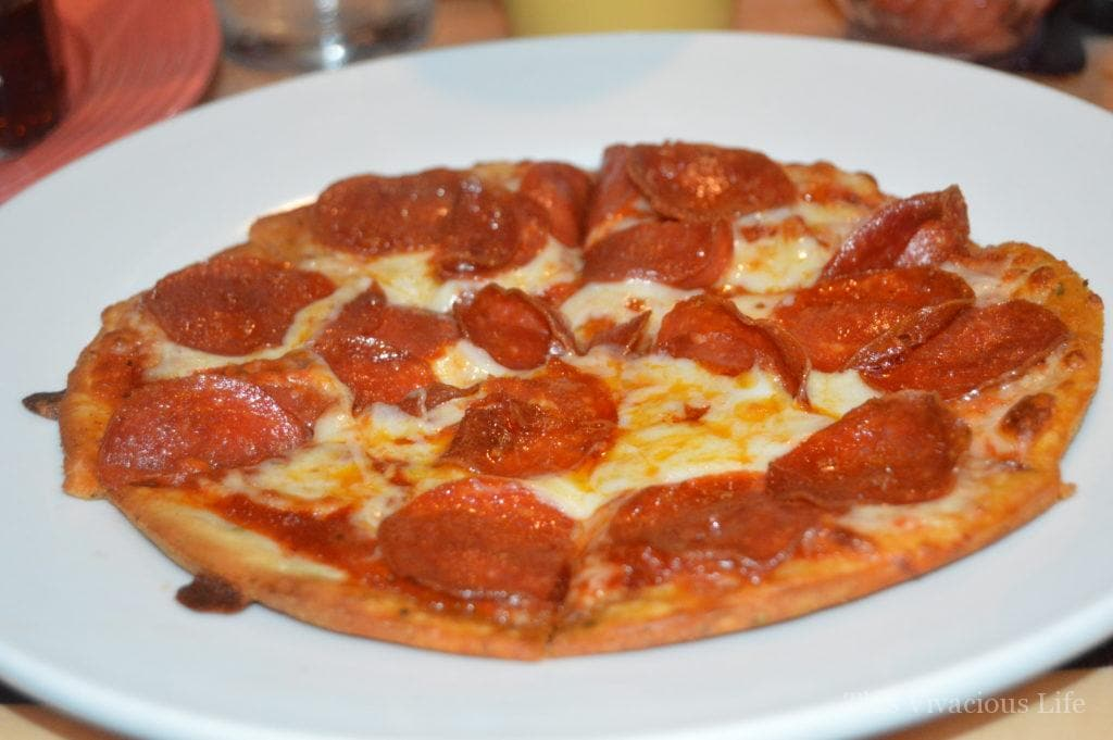 Gluten-free pepperoni pizza on a white plate
