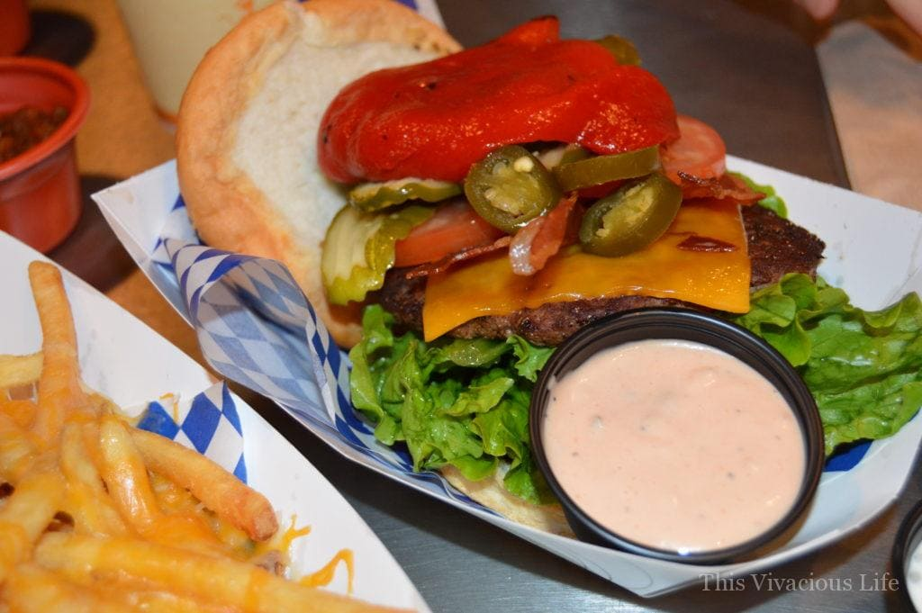 Gluten-free loaded hamburger with fry sauce in a white paper dish