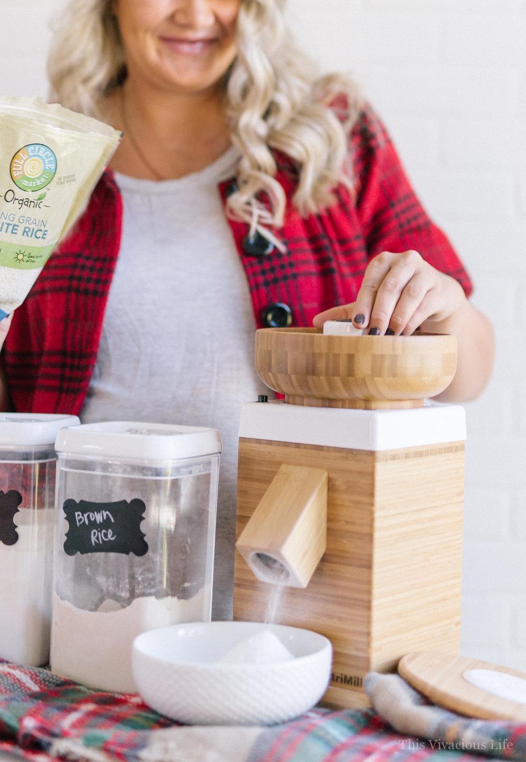 Wood Nutrimill flour grinder with blonde women behind it
