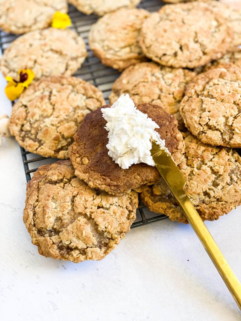 Gluten-Free Oatmeal Cream Pies open with frosting on knife