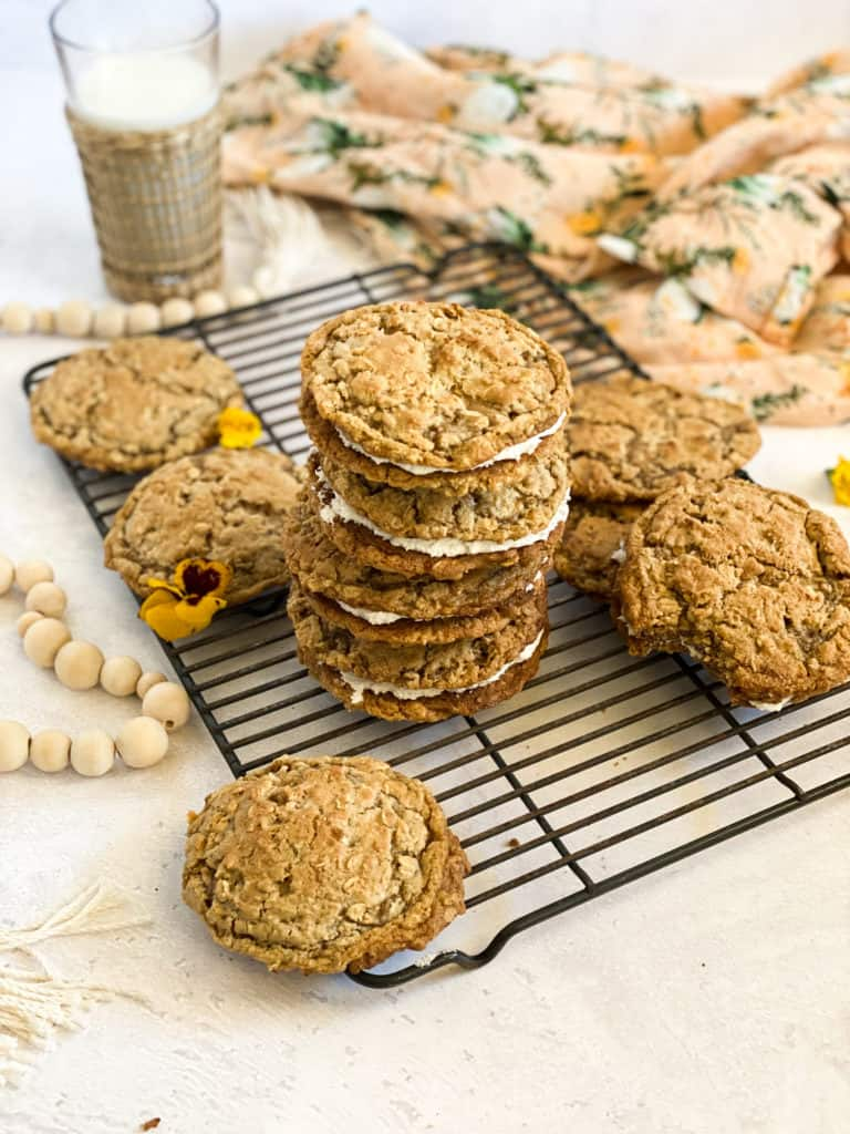 Gluten-Free Oatmeal Cream Pies stacked on a baking rack