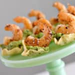 These four ingredient guacamole cups with shrimp are the perfect appetizer. They take only a few minutes to prepare and will definitely be a hit your next party.