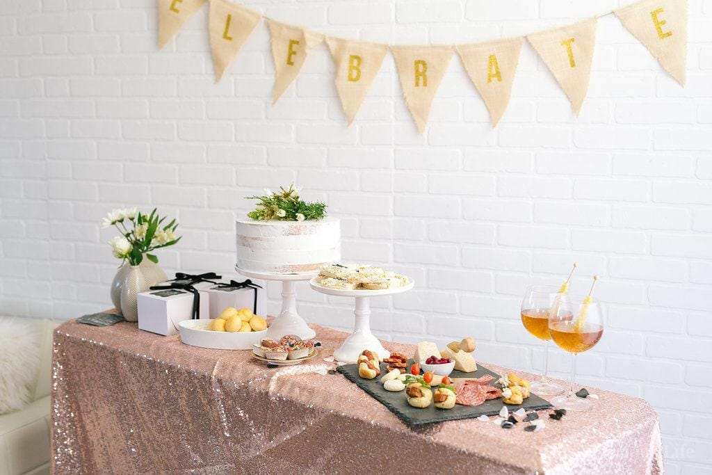This clean slate New Years Eve party is bright and fun with a touch a slate black beauty. There are lots of delicious appetizers and goodies plus some beautiful clean slate resolutions cards for guests to write on. Everyone will go home with some midnight snack boxes as well.