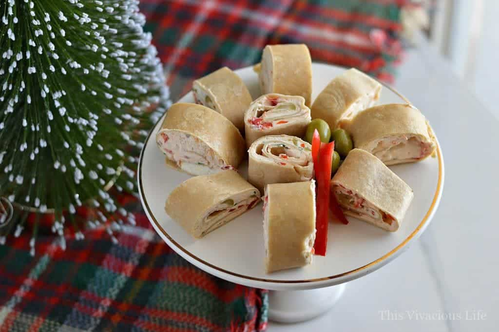 These Christmas party pinwheels tortilla rollups are so delicious and a great holiday appetizer. You are going to love these because they are so easy to make and serve up to a crowd. They are also a gluten-free appetizer.