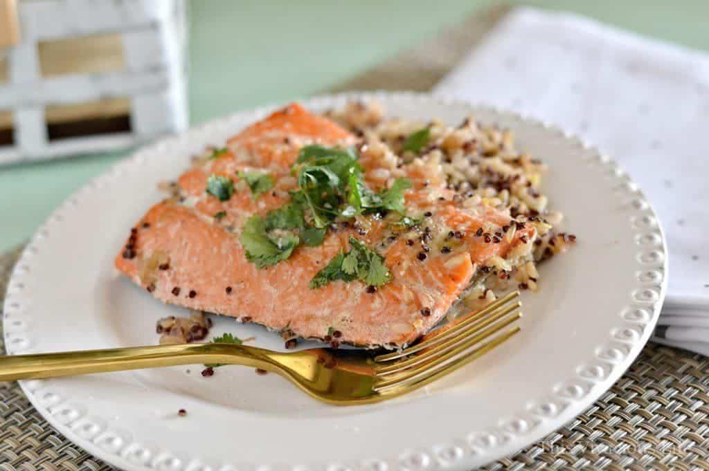 Sockeye salmon om a plate with fresh herbs