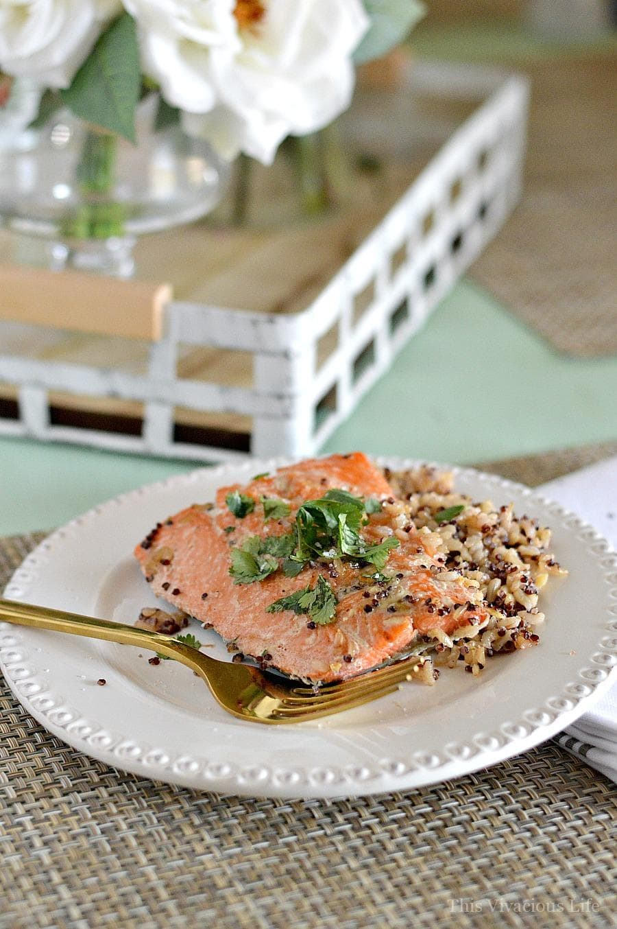 sockeye salmon on a white plate on a table