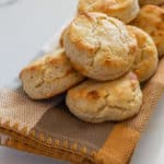 Lots of gluten-free biscuits on a yellow towel on marble