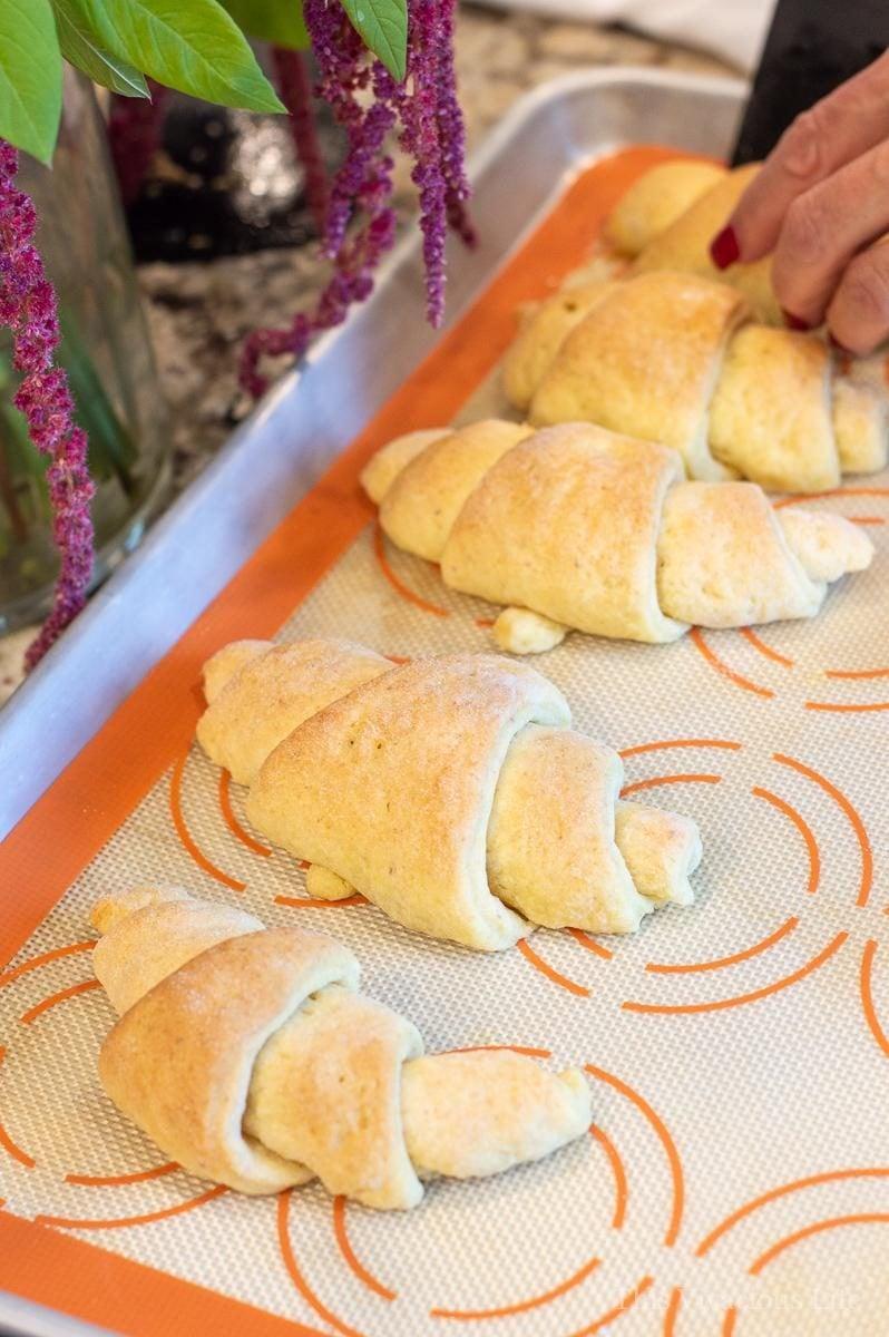 Gluten-free crescent rolls on a baking sheet