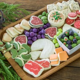 Charcuterie Cheese Board Cookies! These charcuterie cheese board cookies are so realistic and fun! They make a wonderful dessert after a delicious cheese and charcuterie board spread. Really though, these charcuterie sugar cookies made into cracker sugar cookies, cheese sugar cookies, olive sugar cookies, pickle sugar cookies and salami sugar cookies are really going to WOW anyone you serve them too!