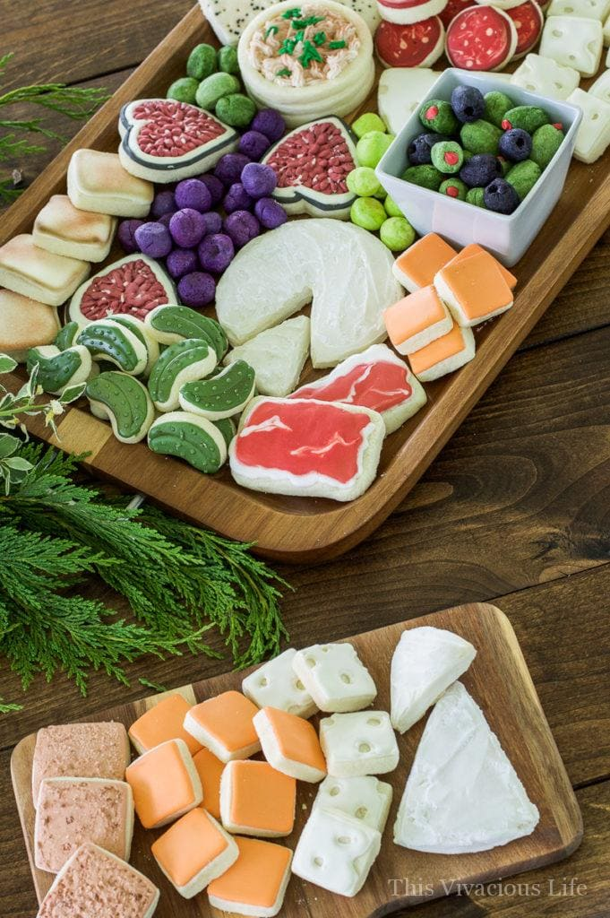 These charcuterie cheese board cookies are so realistic and fun! They make a wonderful dessert after a delicious cheese and charcuterie board spread. || This Vivacious Life #recipe #charcuterie #charcuterieboard #cookies #cookierecipe #funcookies #thisvivaciouslife