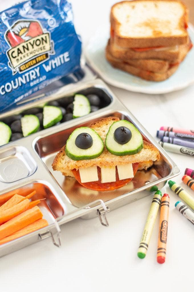 This pizza grilled cheese monster is going to be any kids favorite lunchbox sandwich! They are going to love the whimsy and fun of opening this up in the lunchroom to a funny face. We love using Canyon Bakehouse bread because it is so tasty that nobody would ever know it is gluten-free. AD | lunchbox ideas for kids | fun lunches for kids | sandwich ideas for kids || This Vivacious Life #lunchbox #sandwiches #kidfriendly #backtoschool #lunches #thisvivaciouslife