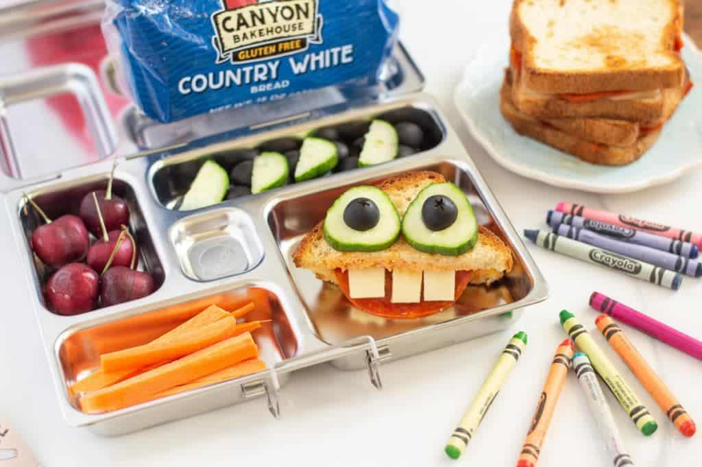 This pizza grilled cheese monster is going to be any kids favorite lunchbox sandwich! They are going to love the whimsy and fun of opening this up in the lunchroom to a funny face. We love using Canyon Bakehouse bread because it is so tasty that nobody would ever know it is gluten-free. AD