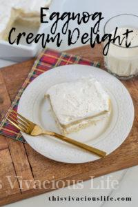 This eggnog cheesecake cream delight is so delicious and full of traditional holiday flavors. It will help bring back nostalgic times of Christmas at grandmas. Plus, it's gluten-free!    This Vivacious Life #glutenfree #eggnog #holidaydesserts #cakerecipes #thisvivaciouslife