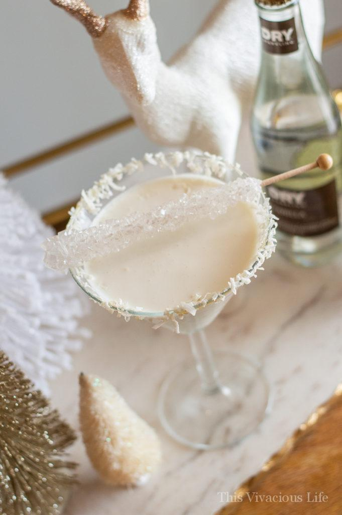 Martini glass with coconut rimmed mocktail white drink