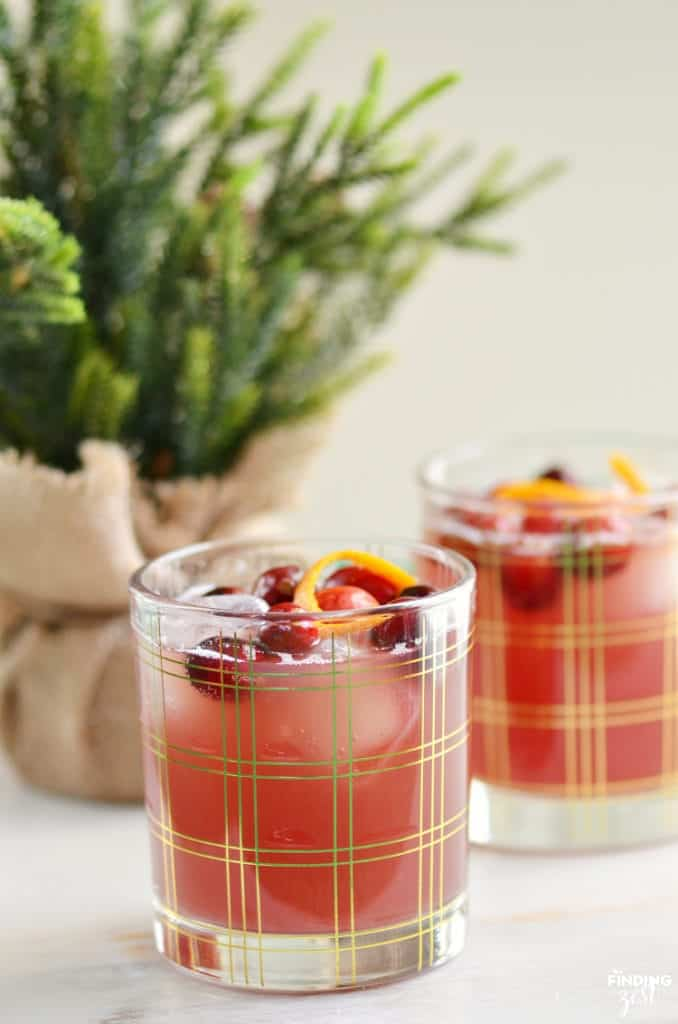 Glass plaid cup with red mocktail and cranberries