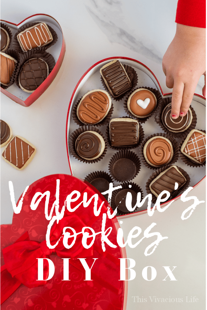 Valentine's Day sugar cookies in a DIY chocolate heart box are a fun gift to give a loved on. Can you only need THREE things to make this cute box?!