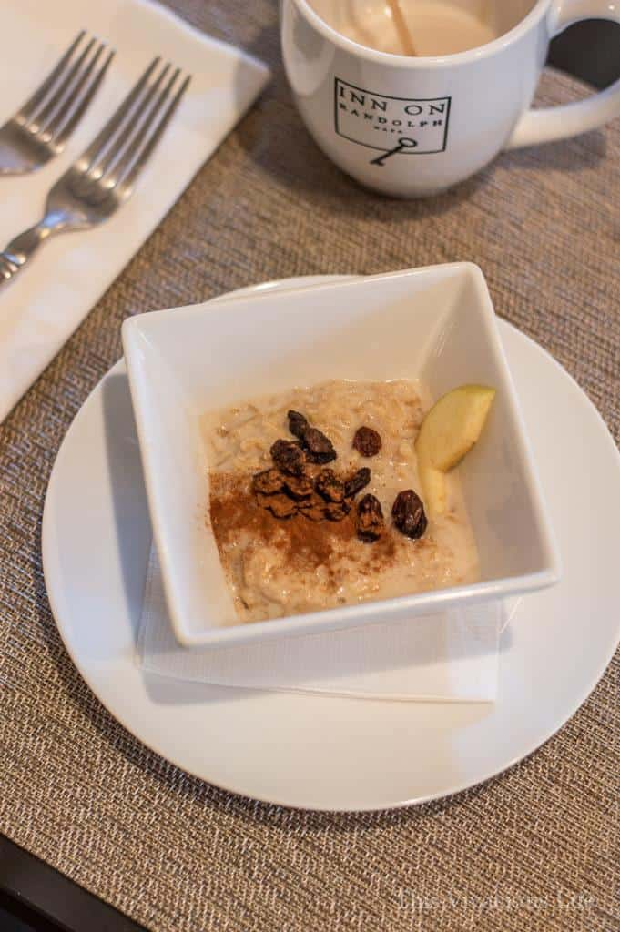 Rice pudding with cinnamon and raisins in a white bowl