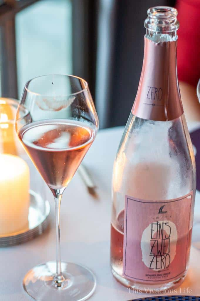 A bottle and a glass of non-alcoholic rose wine