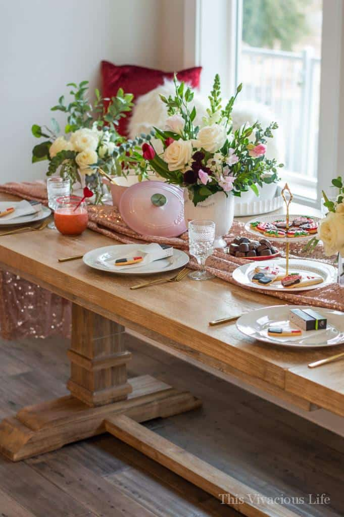 Galentine's tables cape with flowers and dishes