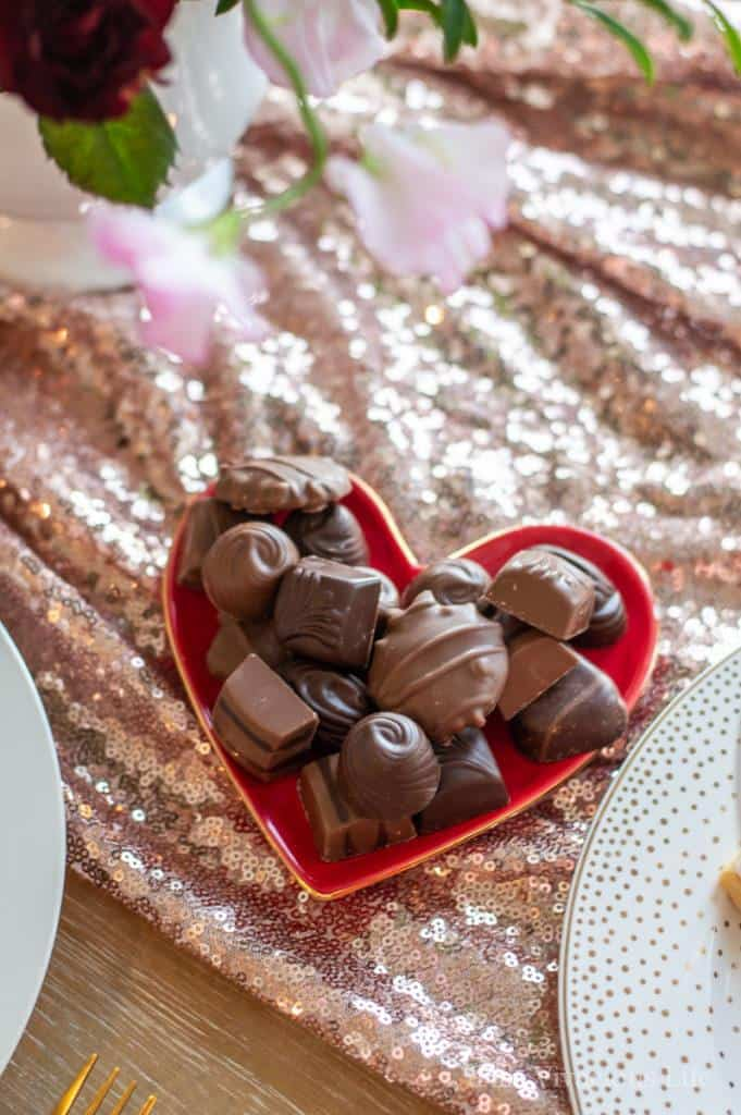 Chocolates on a red heart plate