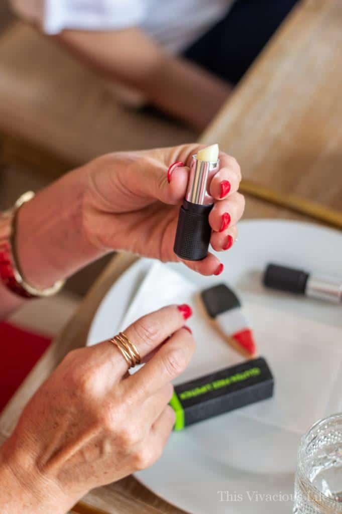 Women's hand holding a lipstick tube