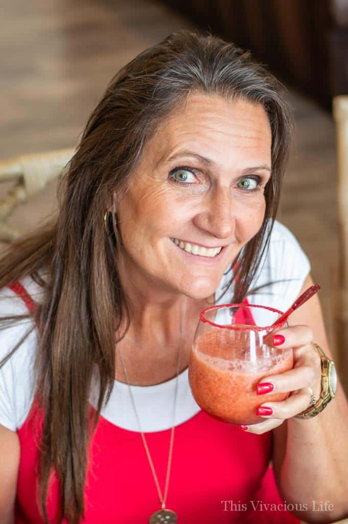 Brown haired woman holding a red drink