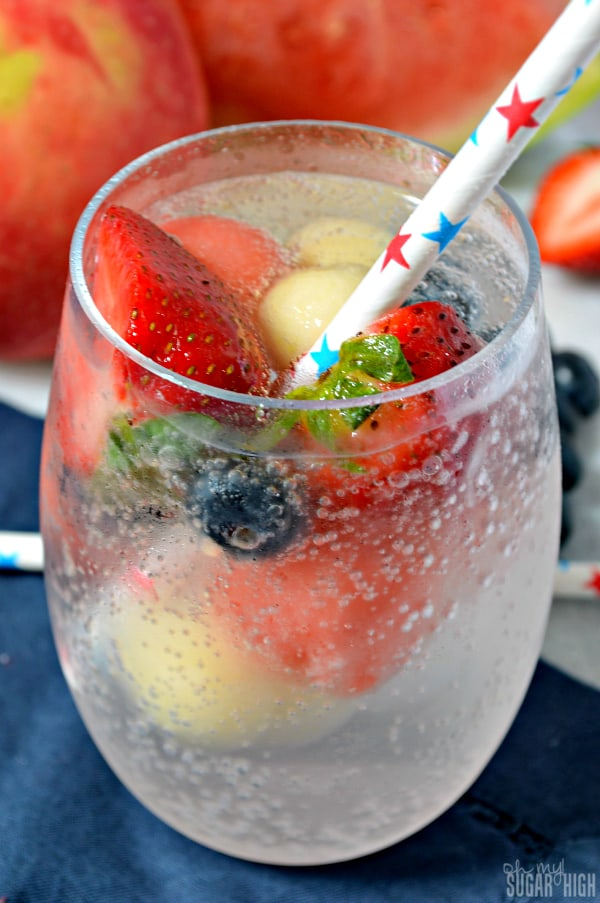 Patriotic water in a glass with a straw