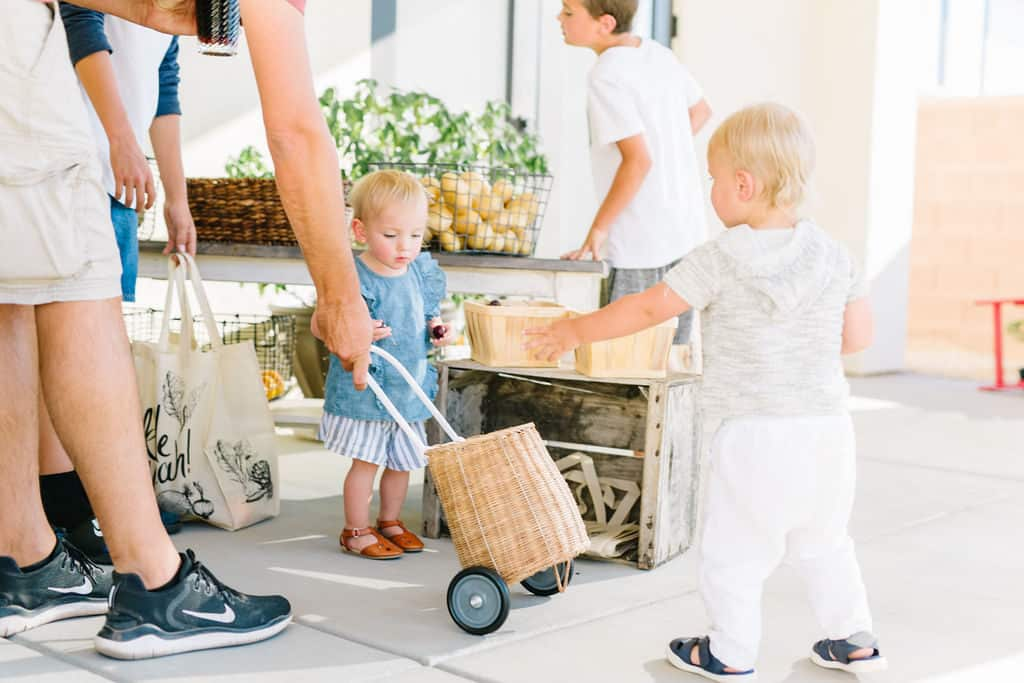 Kids shopping at a mini farmers market