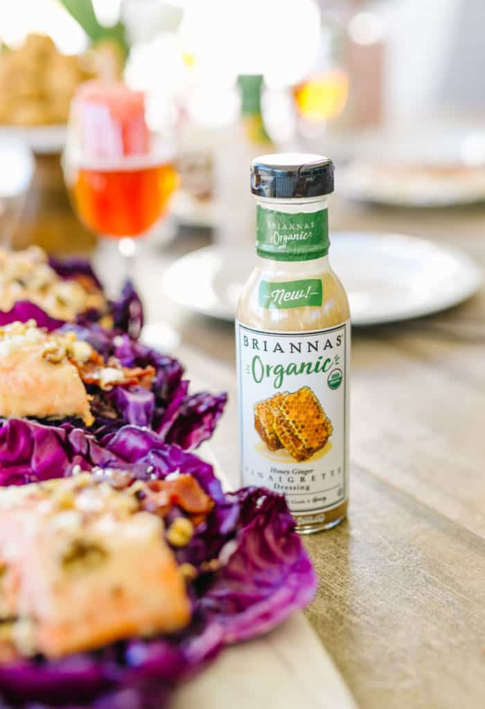 Bottle of BRIANNAS organic dressing next to cabbage cups