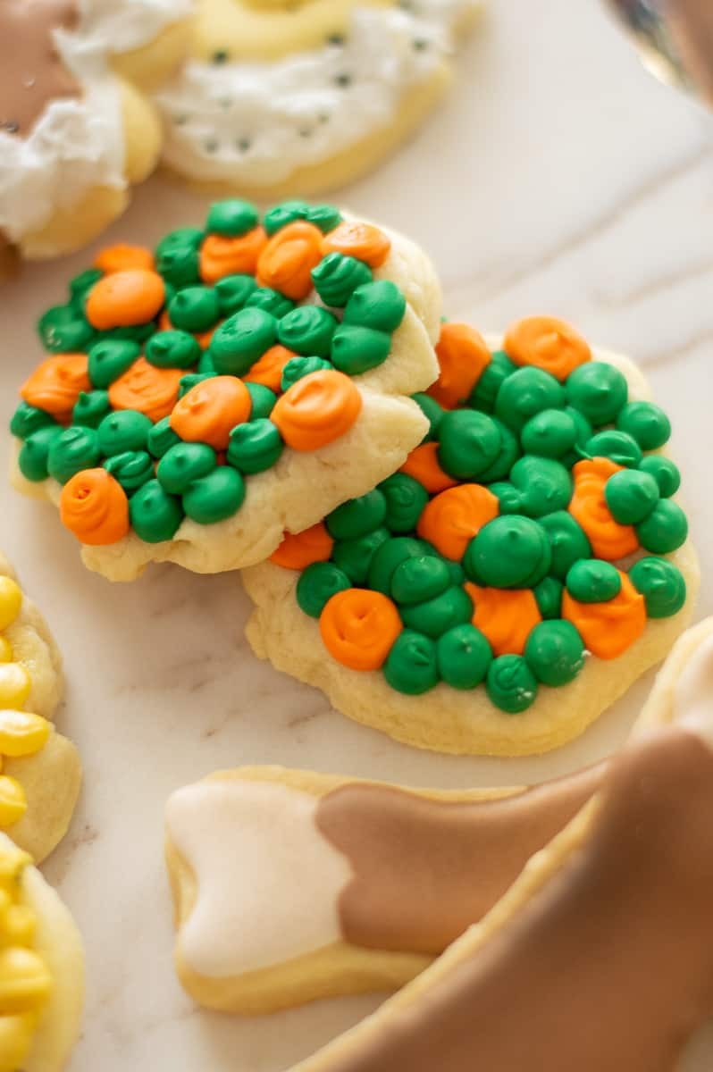 Peas and carrots decorated sugar cookies