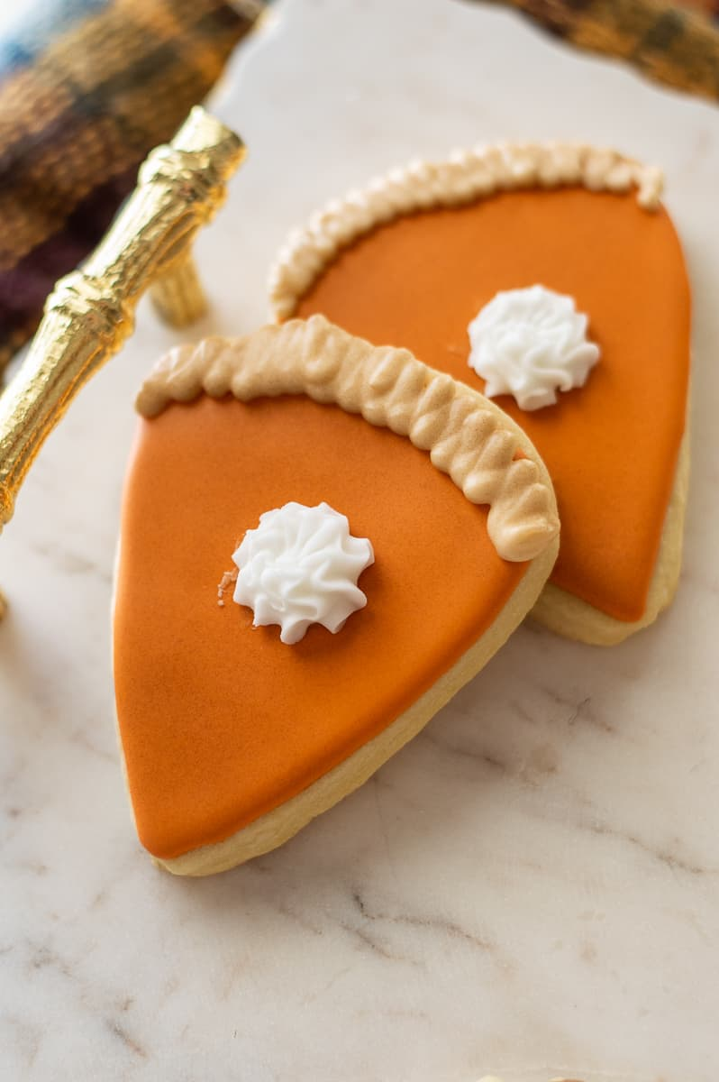 Pumpkin pie sugar cookies on a marble platter