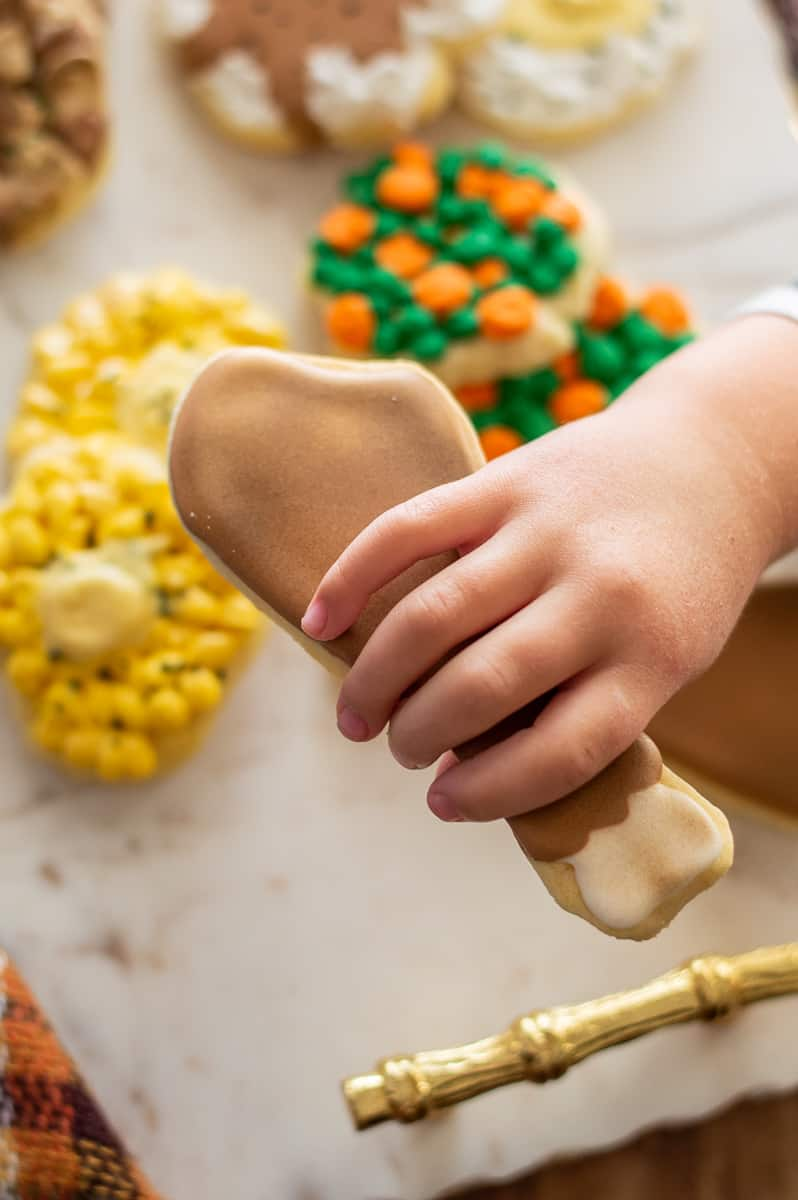 Hand holding a turkey sugar cookies