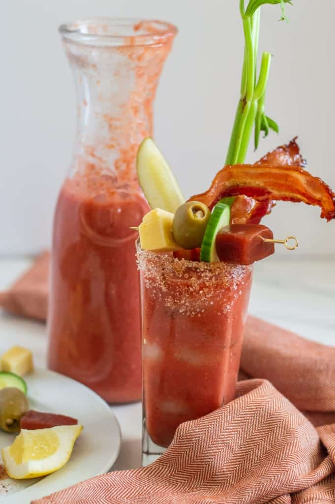 non-alcoholic Bloody Mary in a glass with garnish and red towel