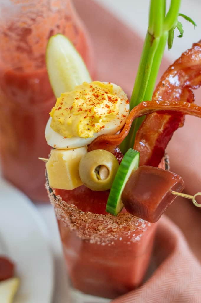 Bloody Mary martini mocktail in a glass with tons of garnish