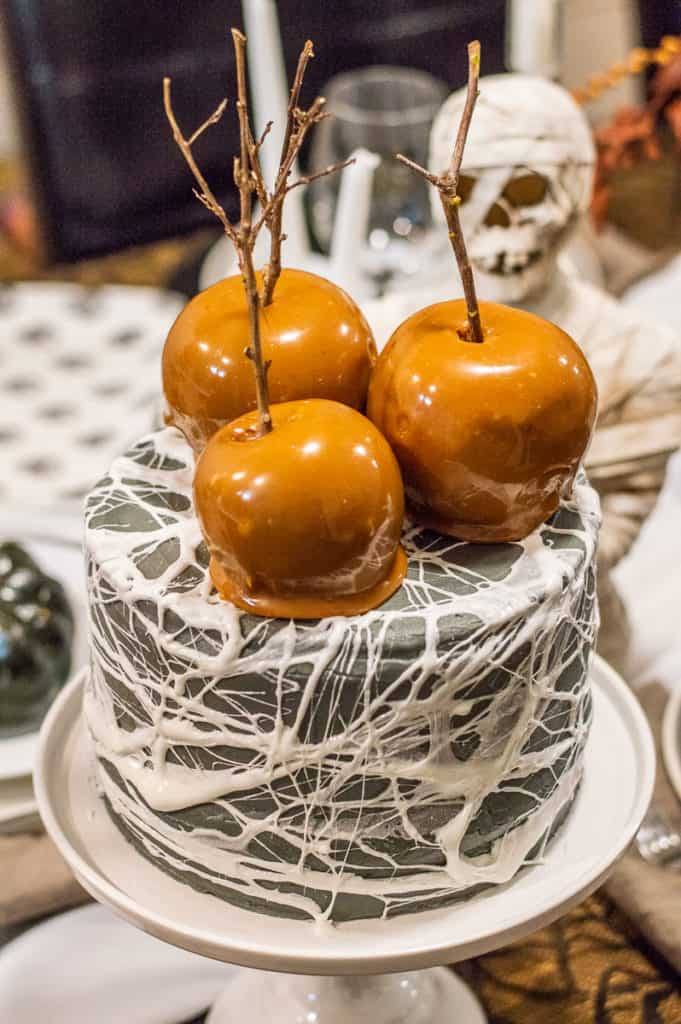 Halloween cake with caramel apples and marshmallow cobwebs