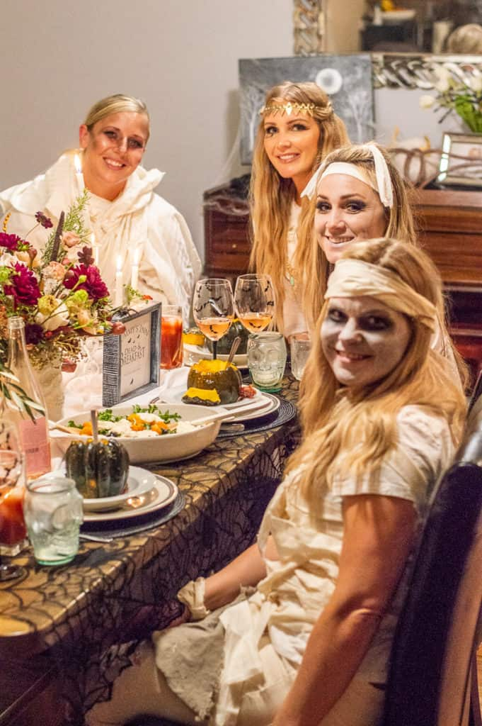 Mummy costume girls at a table
