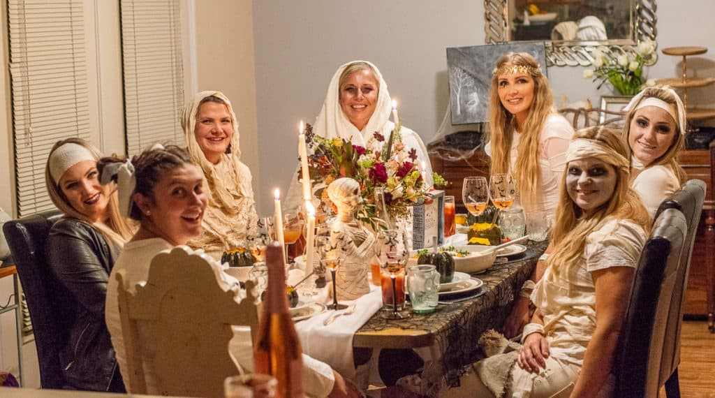 Mummy costume girls sitting at a table