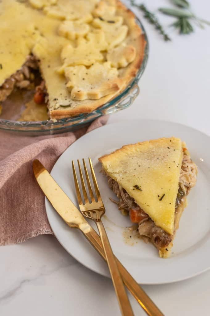 Slice of gluten-free chicken pot pie with gold flatware