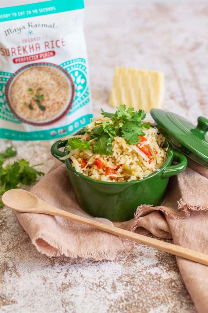 Green Chile rice with cilantro in a green bowl