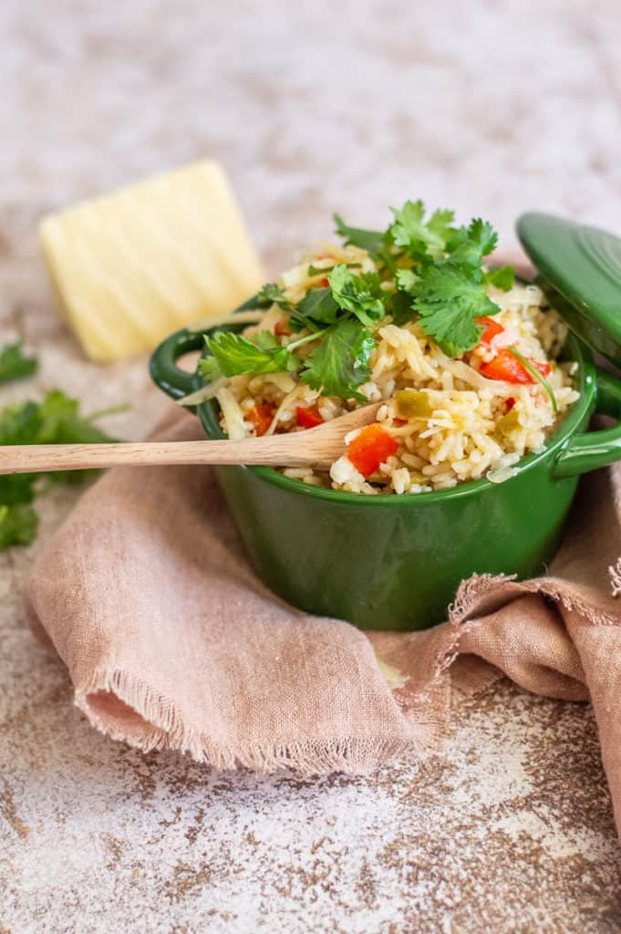 Green Chile rice in a. green bowl with cilantro