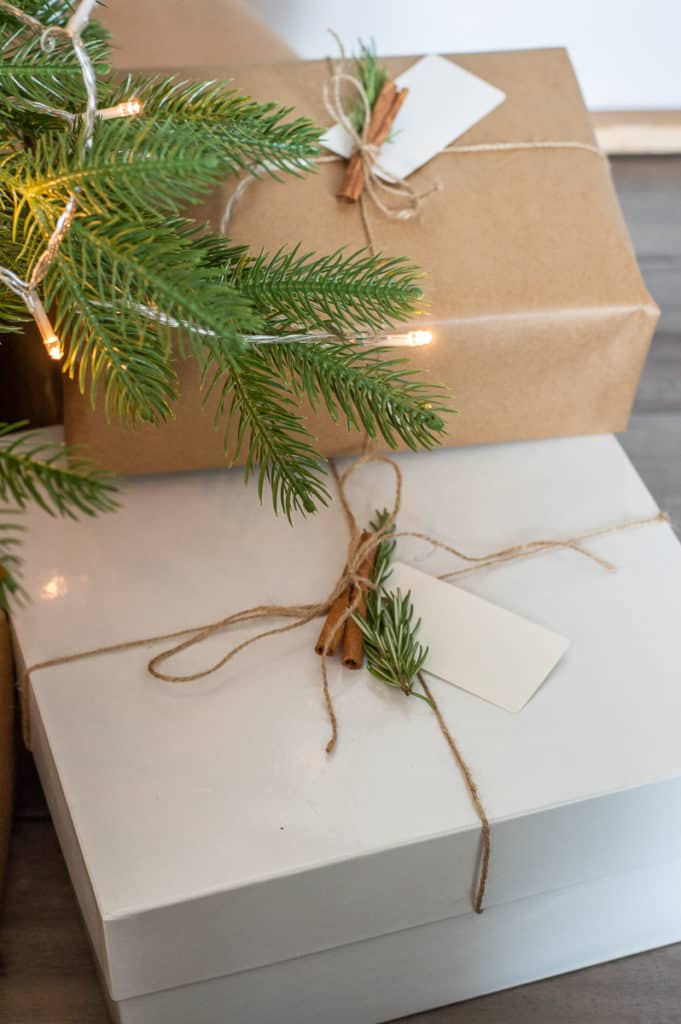 DIY Kraft paper wrapped christmas presents with cinnamon, twine and rosemary