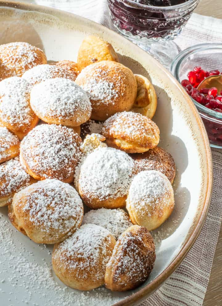 Ebelskivers recipe in a big bowl with powdered sugar