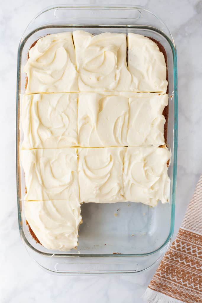 Overhead shot of eggnog cake with eggnog cream cheese frosting in a pan