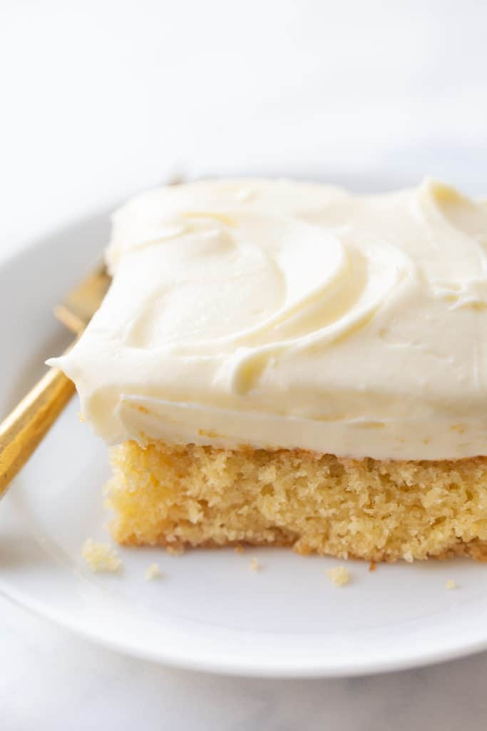 Slice of eggnog cake with eggnog cream cheese icing