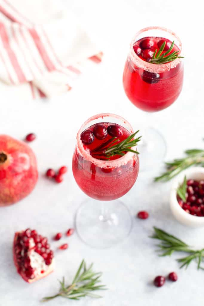 Prosecco drink with pomegranate and cranberries in a glass