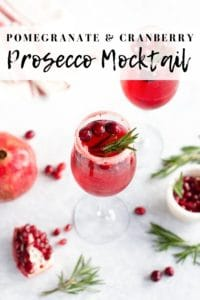 Prosecco drink mocktail with pomegranate and cranberries