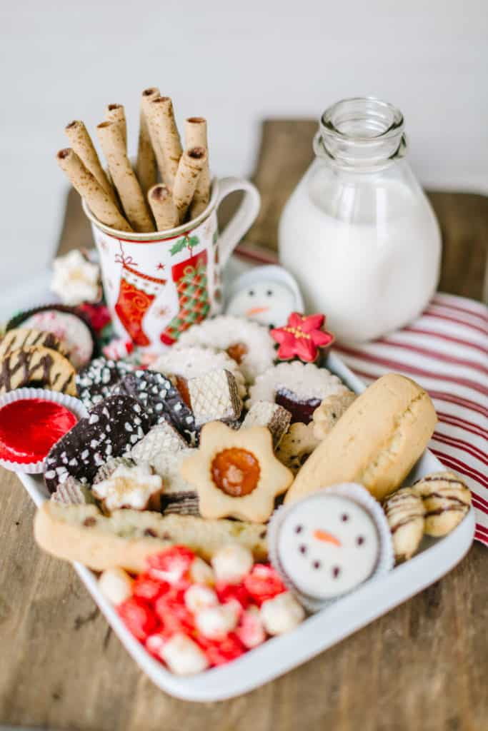 White tray with Christmas cookies and milk