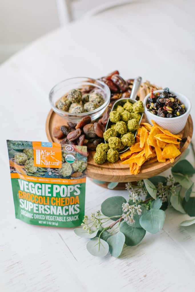 Wood board with healthy holiday snacks and a bag